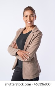 Headshot of mixed race business woman in studio isolated on grey