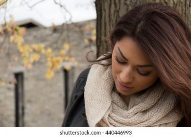 Headshot portrait of an attractive, fresh hispanic woman