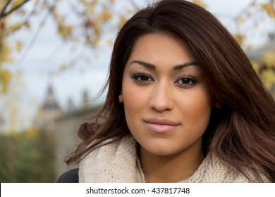 Head-shot portrait of an attractive, fresh latino woman