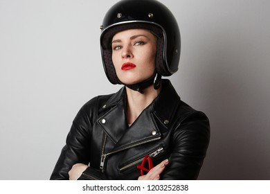 Headshot Portrait of fashion girl with red lips in black leather jacket smiling looking at camera over white background. Fashion, glamour and moto wear concept