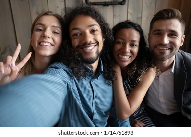 Headshot portrait of friends smile make selfie in cafe together, self-portrait picture of overjoyed happy  diverse colleagues have fun relaxing in coffee shop on weekend