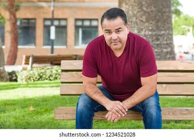 Headshot Portrait of Handsom Hispanic Man.