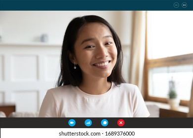 Headshot portrait screen application view of happy millennial Asian girl talk on video call online, smiling young ethnic woman speak have pleasant Webcam chat on laptop, quarantine alone at home