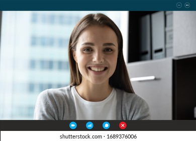 Headshot portrait screen application view of smiling millennial woman have pleasant Webcam conference in office, happy young female speak talk on video call online, use wireless Internet at home