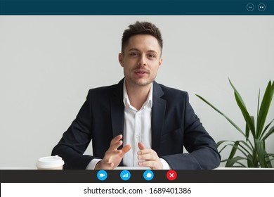 Headshot portrait screen application view of male employee have online interview using Web conference on computer, young businessman speak talk on video call on laptop with partner from home