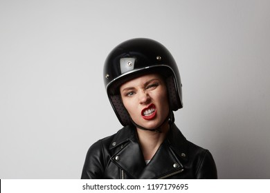 Headshot Portrait of sexy girl with red lips in black leather jacket smiling looking at camera. White background. Fashion, glamour and emotions concept