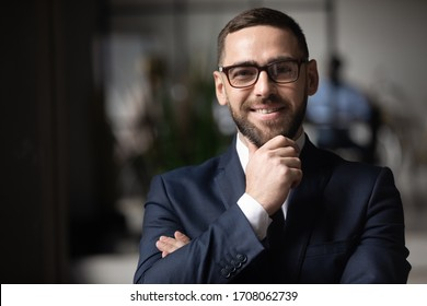 Headshot portrait of smiling middle-aged caucasian businessman in glasses look at camera with confidence, happy male boss or director in spectacles posing for picture at office, leadership concept