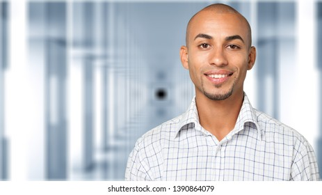 Headshot portrait of young man smiling isolated