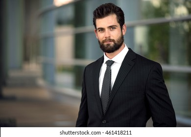 Headshot pose portrait of a modern attractive business man with a beard