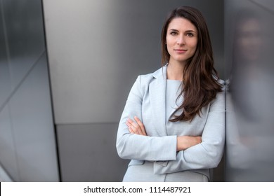 Headshot of successful business lawyer working executive professional with strong serious confident pose