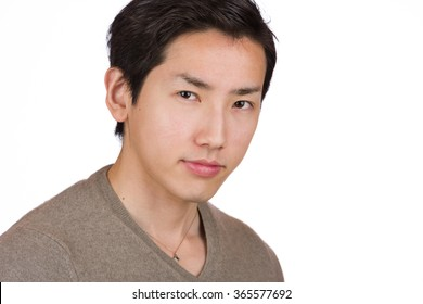 A headshot of a young handsome Japanese man.