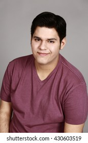 headshot of young hispanic man smiling