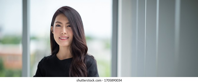Headshot young lady standing in office
