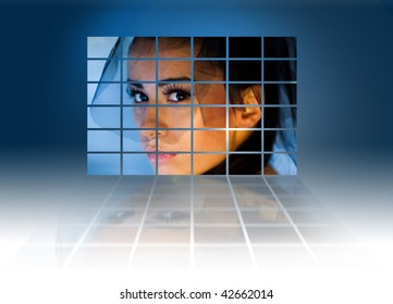 Headshot of a young sexy woman on large video wall. Television production technology concept