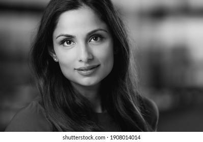 Headshots of beautiful Asian Indian woman in an office setting.