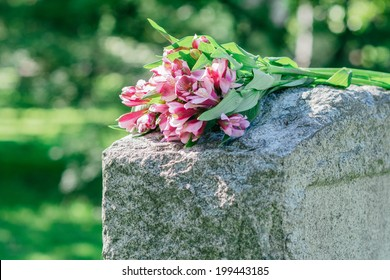 Image result for Flowers on a grave