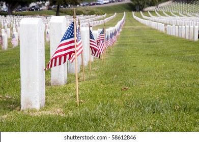 Headstones with American flags.