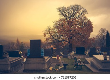 Headstones in a cemetery an autumn day