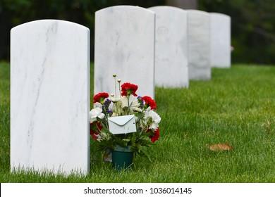 Headstones and flowers in Arlington National cemetery-Circa Washington DC USA