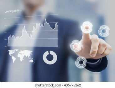 Head-up display interface showing business intelligence dashboard and charts with businessman fingers touching virtual buttons