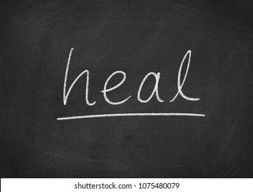 heal concept word on a blackboard background