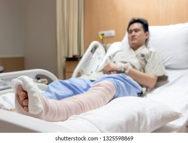 heal weir bone broken leg with accident on bed hospital bed after surgery cast.