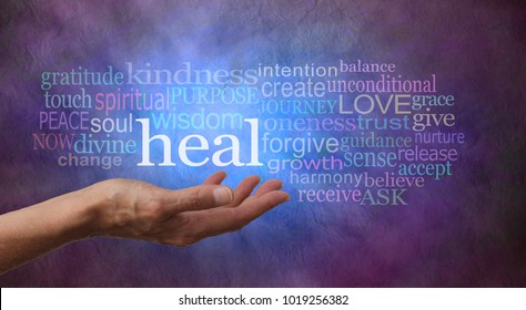 Heal Word Cloud - female hand gesturing towards the word HEAL surrounded by a relevant word tag cloud on a rustic blue and purple ethereal colored background with dark vignette edged border