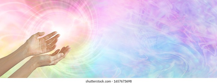 Healer working with colour healing full spectrum energy  - female cupped hands sensing  rainbow coloured vortex with  copy space