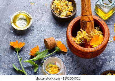 Healing calendula flowers and herbal tincture.Medical herbs