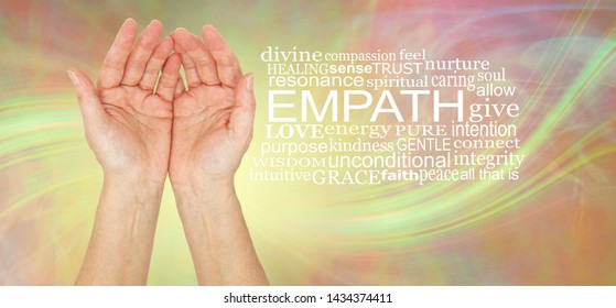 The healing hands of an empath - pair of female hands gently cupped beside an EMPATH word cloud against a lemon laser light swish energy background