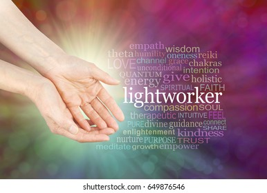 The healing hands of a Lightworker  - Female hands in open gesture beside the word LIGHTWORKER and a relevant word cloud  on a radiating multicolored bokeh background