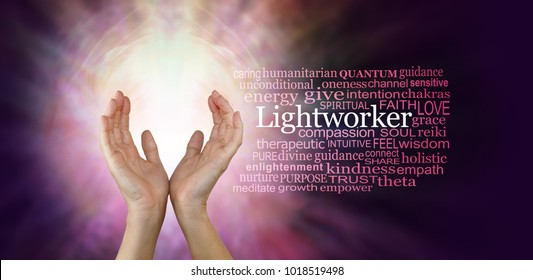 The healing hands of a Lightworker - Female hands in an upwards open gesture beside the word LIGHTWORKER and a relevant word cloud  on a radiating pink coloured energy background