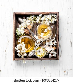 Healing herbal tea with honey from acacia flowers.Herbal tea
