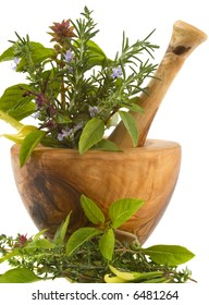 Healing herbs and edible flowers (hand carved olive tree mortar and pestle)