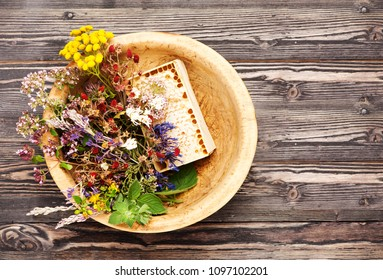 Healing herbs for herbal tea and honeycomb, top view, flat lay