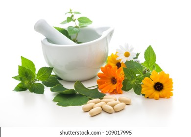 Healing herbs and mortar. Alternative medicine concept