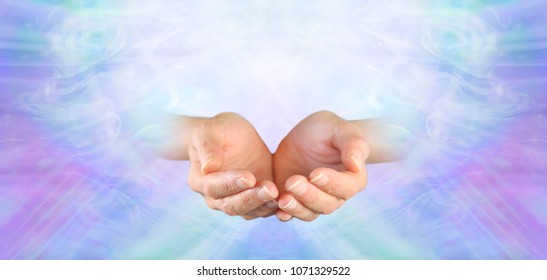 Healing offered with Unconditional Love - female cupped hands on a subtle pink purple blue green flowing energy background