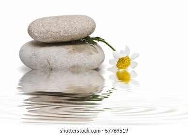 Healing stones and flowers in zen balance.