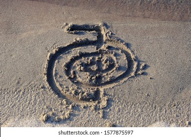 Healing symbol of Cho ku Rei drawn finger on sand for alternative healing with the help light energy Reiki. Can be used to increase the flow of energy or to accelerate something.