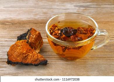 Healing tea from birch mushroom chaga is used in folk medicine. Coffee. Chaga tea. Chaga mushroom.