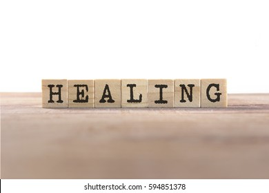 Healing Word Written In Wooden Cube