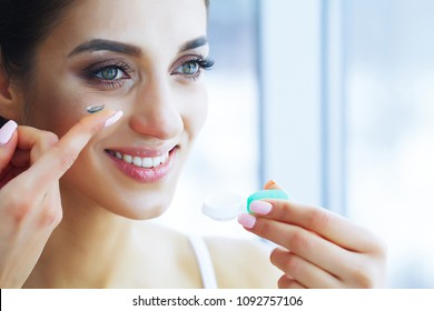 Health and Beauty. Beautiful Young Girl with Contact Lenses. Woman Holds Green Contact Lens on Her Finger. Healthy View. High Resolution
