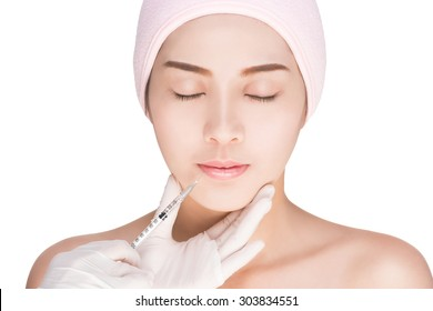 health and beauty concept - Beautiful woman gets an injection in her face , dermal fillers injection, isolated on white with clipping path.
