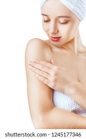 Health and beauty concept. Close-up of a beautiful woman cares about her shoulder isolated on a white background