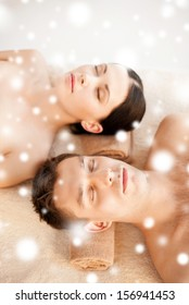 health and beauty concept - couple in spa salon lying on the massage desks
