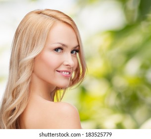 health and beauty concept - face and shoulders of happy woman with long hair