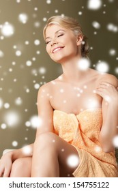 health and beauty concept - happy woman in spa salon