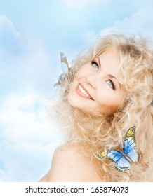 health and beauty concept - happy woman with butterflies in hair