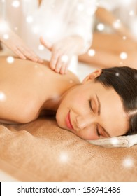 health and beauty concept - woman in spa salon getting massage