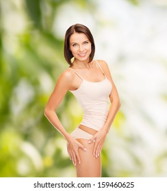 health and beauty, eco, bio, nature concept - woman in cotton underwear showing slimming concept